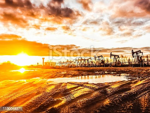 Oil rocking at sunset. Oil industry Oil rocking at sunset. Oil industry
