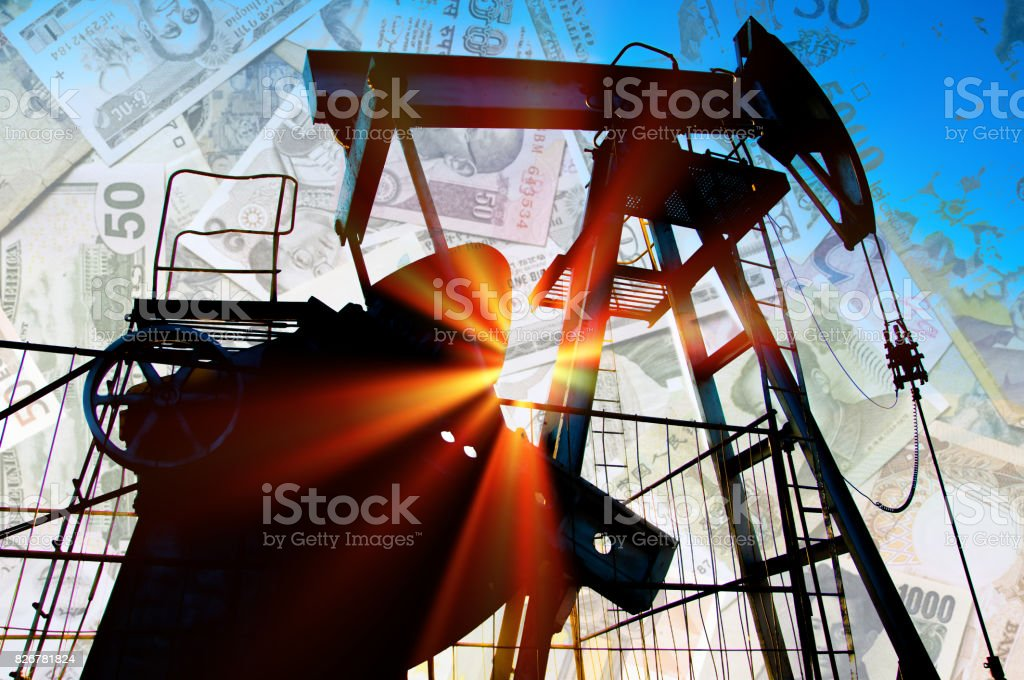 Oil rocking chair on the field sown with wheat stock photo
