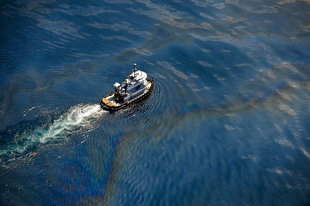 oil slick - emergency response stock pictures, royalty-free photos & images