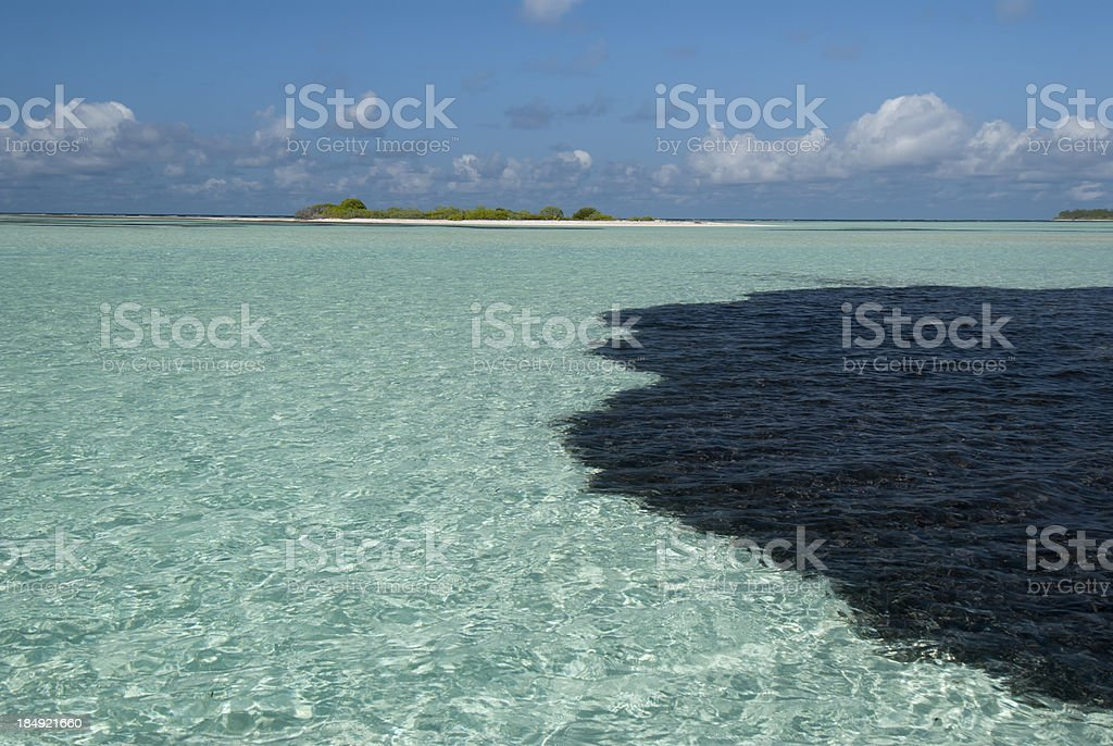 oil spill at a tropical island stock photo