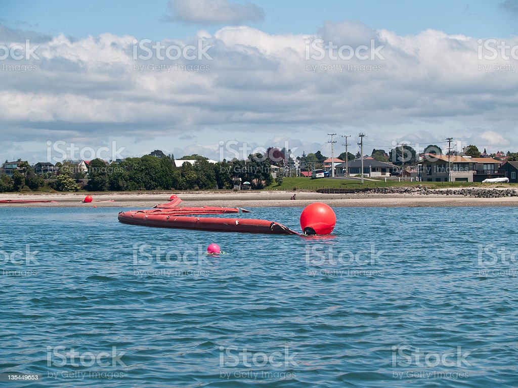 Oil spill boom in Tauranga harbour. stock photo