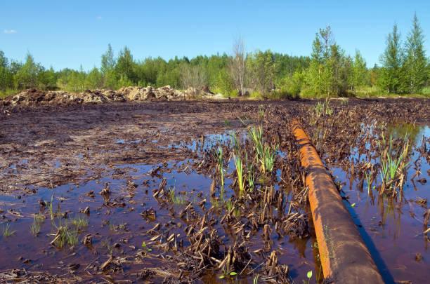Oil spill on the pipeline stock photo