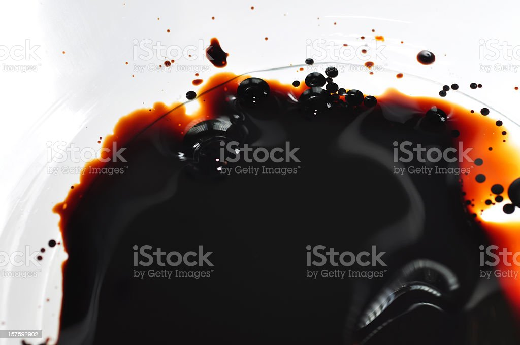 Oil spilled into clear water in a white bowl royalty-free stock photo