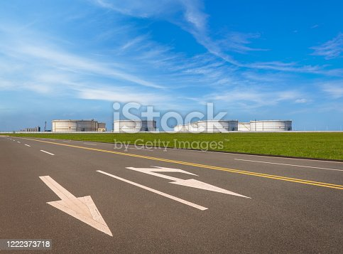Oil storage tank under blue sky and white clouds