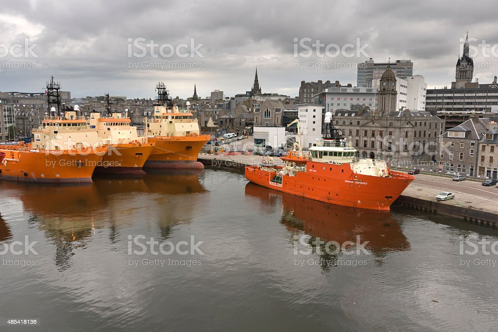Oil support vessels in dock at Aberdeen in Scotland stock photo