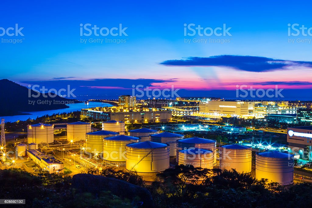 Oil tank in the twilight stock photo