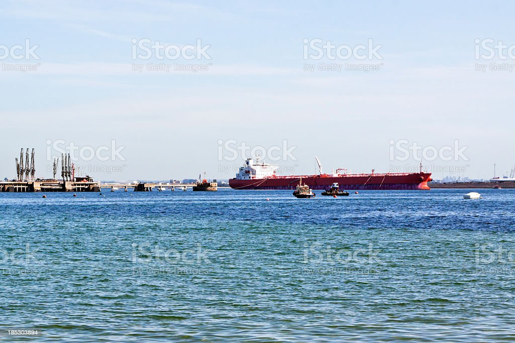 OIl tanker and tug boats at port of oil refinery royalty-free stock photo