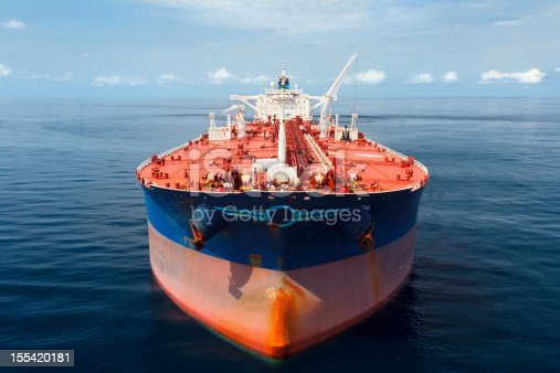 Aerial photo of a large oil tanker floating in calm seas.