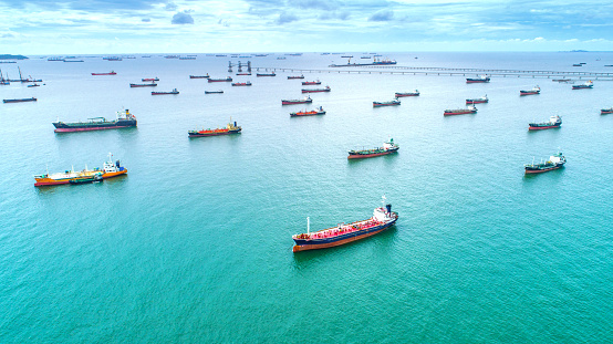 oil tanker, gas tanker in the high sea.Refinery Industry cargo ship. top view,aerial view,Thailand, in import export, LPG,oil refinery, Logistics and transportation with working crane bridge in harbor