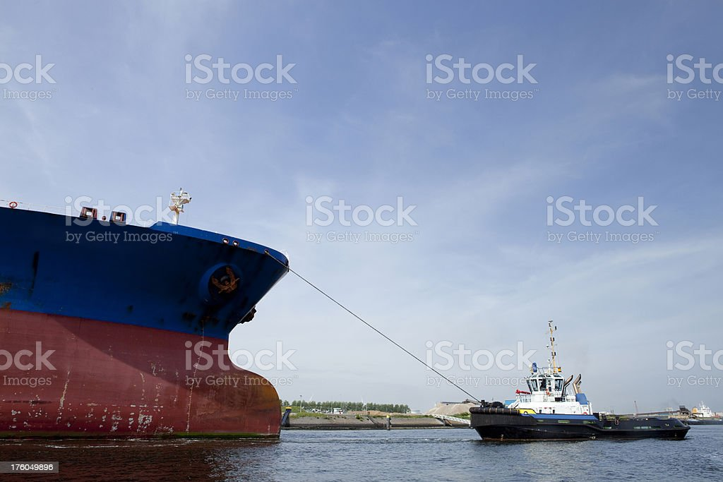 Oil tanker with tug-boat royalty-free stock photo