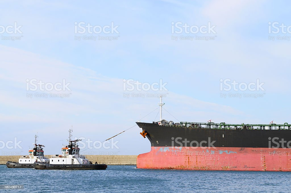Oil tanker with two tug boats royalty-free stock photo
