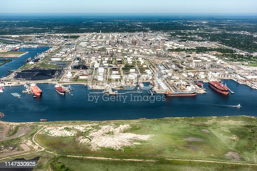 Aerial view of tankers docked at an American oil refinery in Texas City, Texas, located just south of Houston on Galveston Bay.