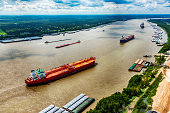 A line of oil tankers transporting fuel to the refineries located along the Mississippi River just north of New Orleans, Louisiana.