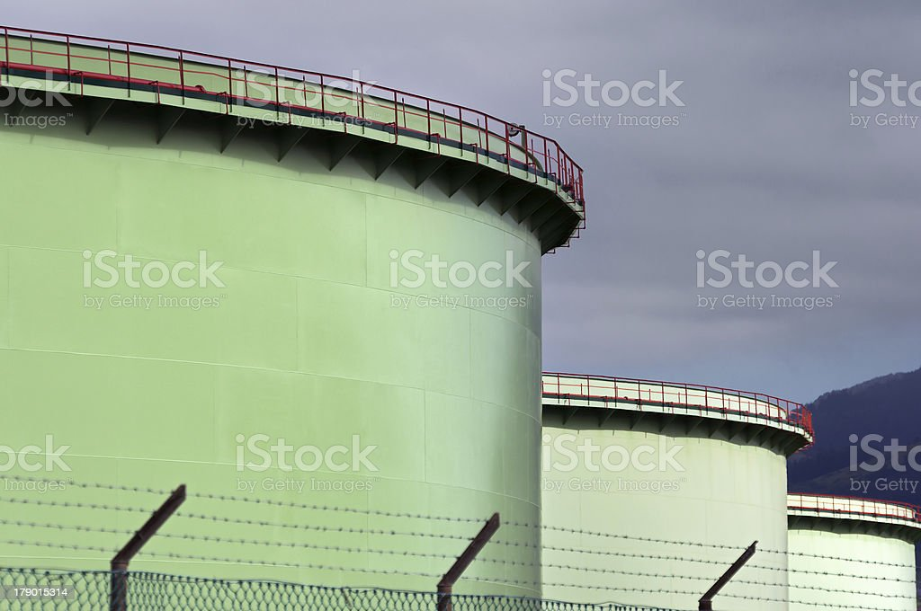 oil tanks with security fence royalty-free stock photo