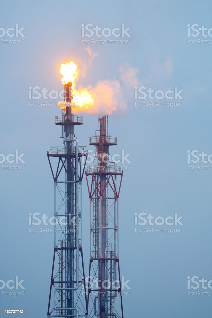 Oil tower combustion in oil field at night