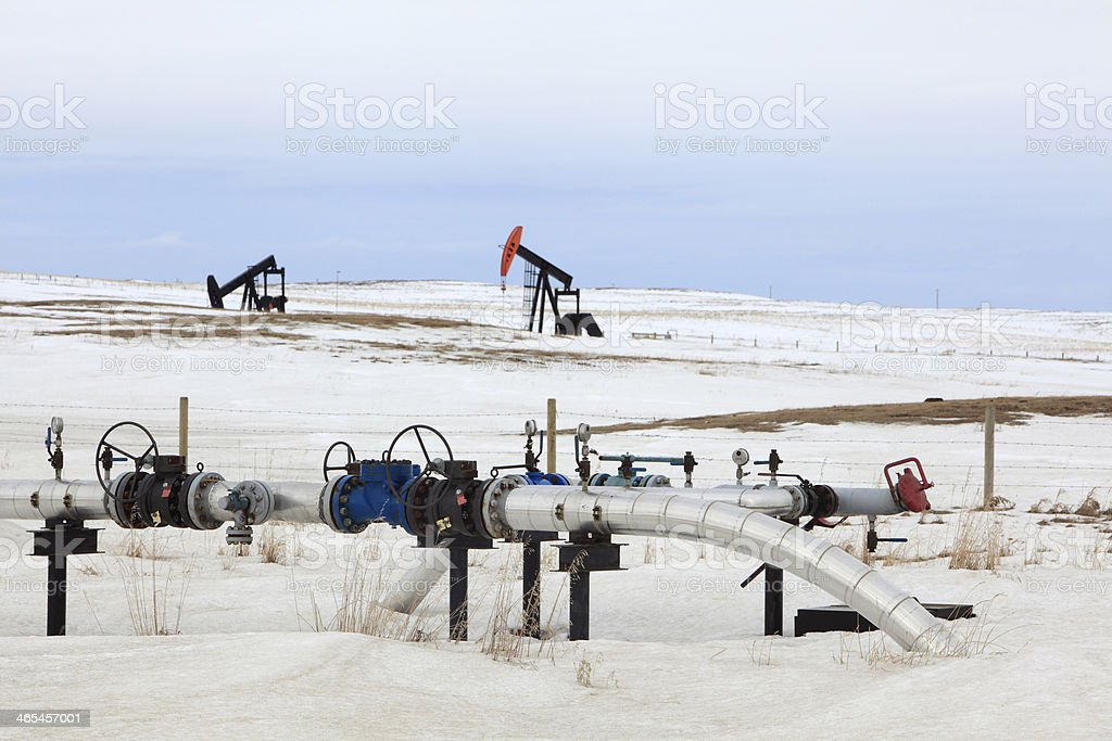 Oil Transmission Lines In Winter With Pumpjacks royalty-free stock photo