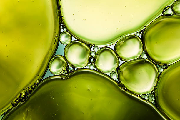 Oil & Water - Abstract Background Green Macro 2.5:1 macro photography of oil and water. macrophotography stock pictures, royalty-free photos & images