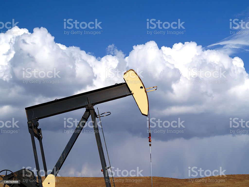 Oil Well Pumpjack - Storm Approaching royalty-free stock photo