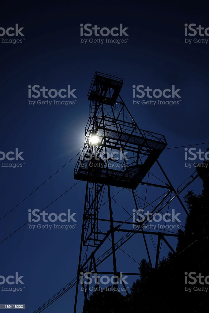 oil well tower at sunset royalty-free stock photo