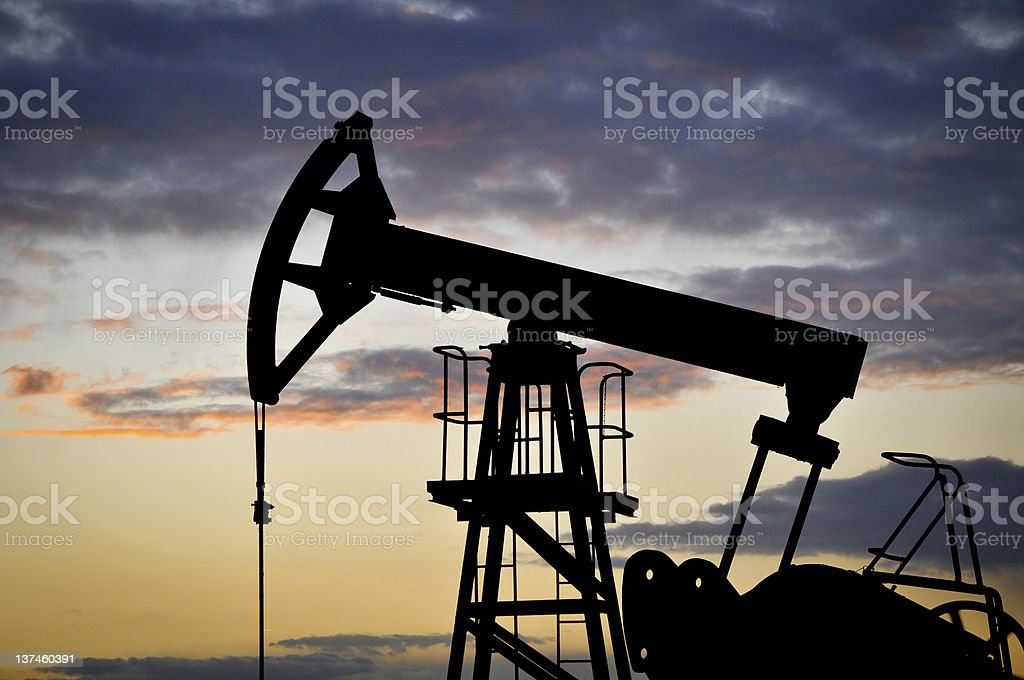OIl wells at dawn stock photo