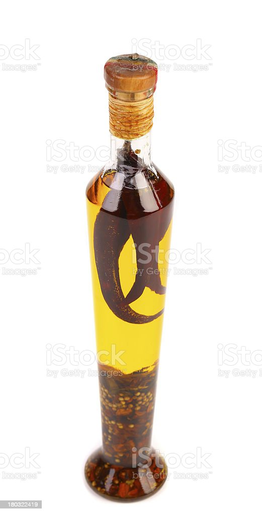 Oil with spicery into bottle. royalty-free stock photo