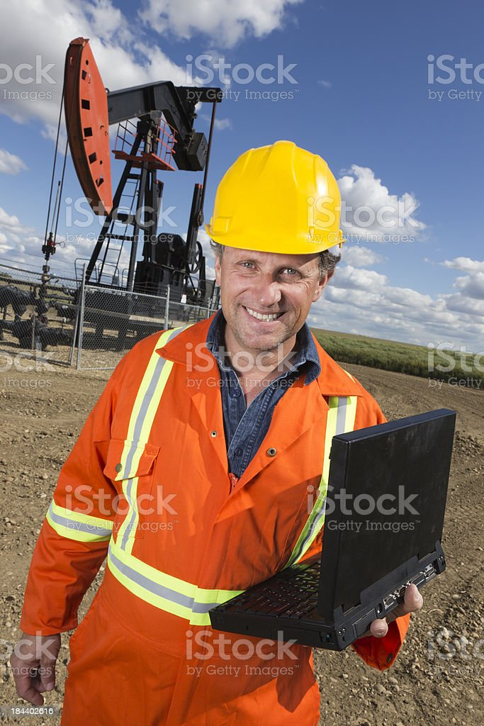 Oil Worker and Computer royalty-free stock photo