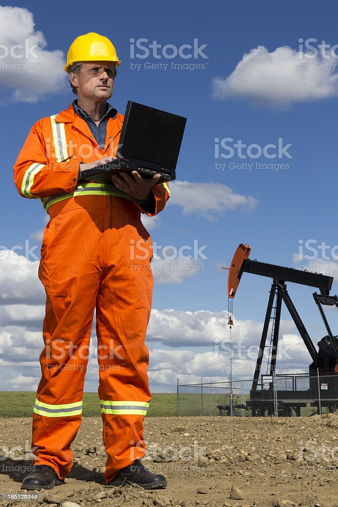 Oil Worker and Computer stock photo