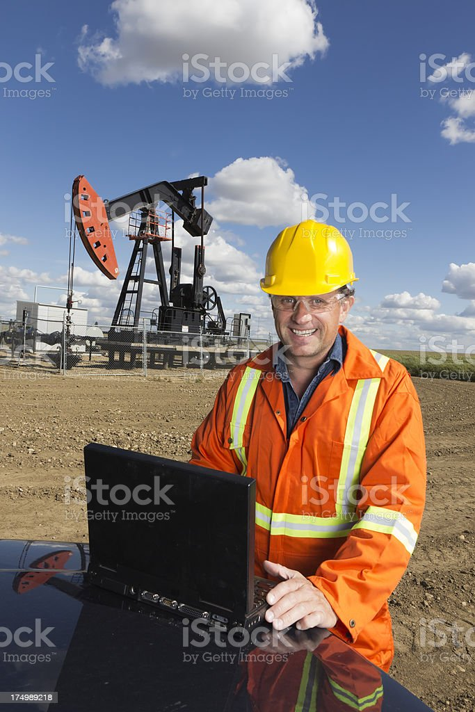 Oil Worker and Laptop stock photo