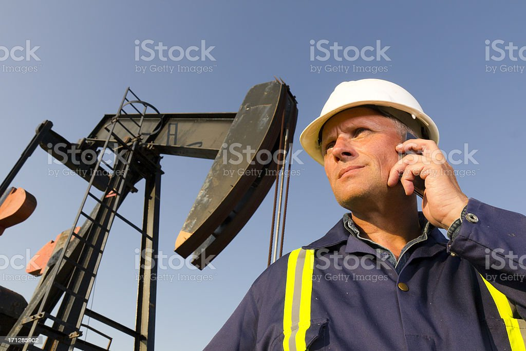 Oil Worker and Smartphone royalty-free stock photo