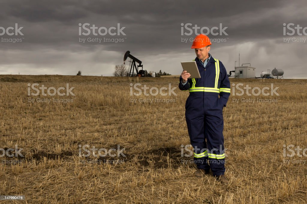 Oil Worker and Tablet royalty-free stock photo