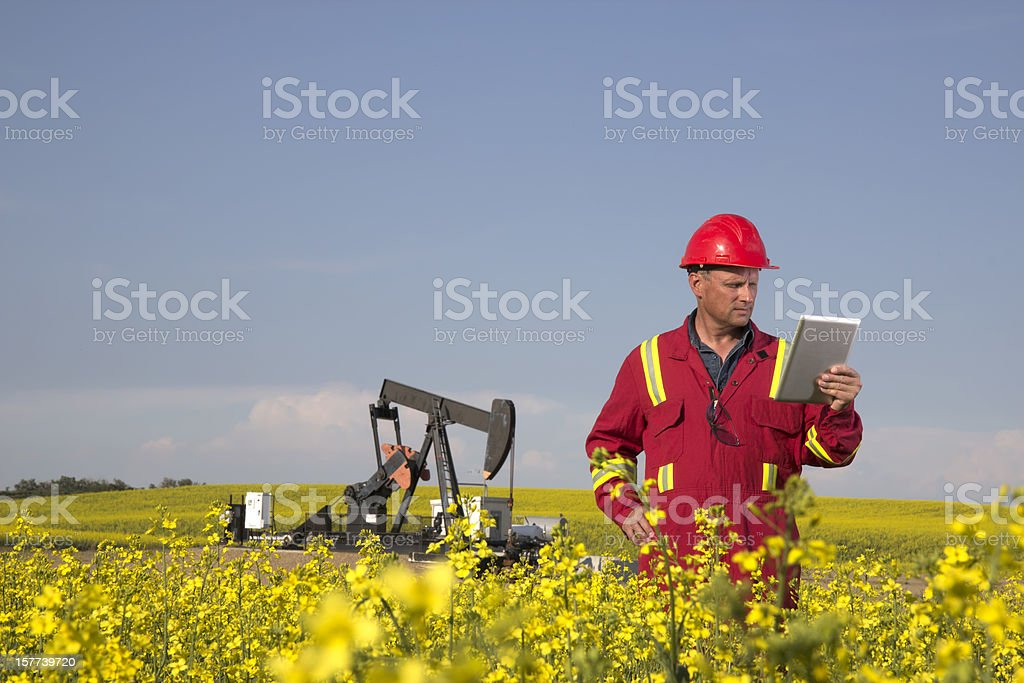 Oil Worker and Wireless Technology royalty-free stock photo