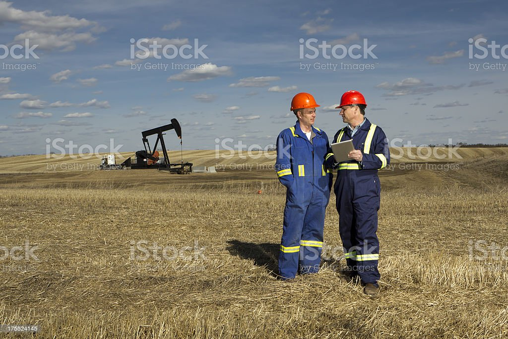 Oil Worker Meeting stock photo
