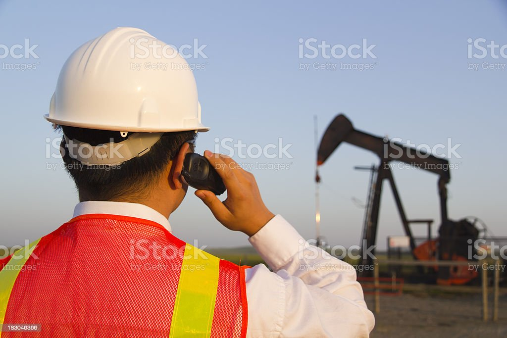 Oil Worker on a Cell Phone royalty-free stock photo