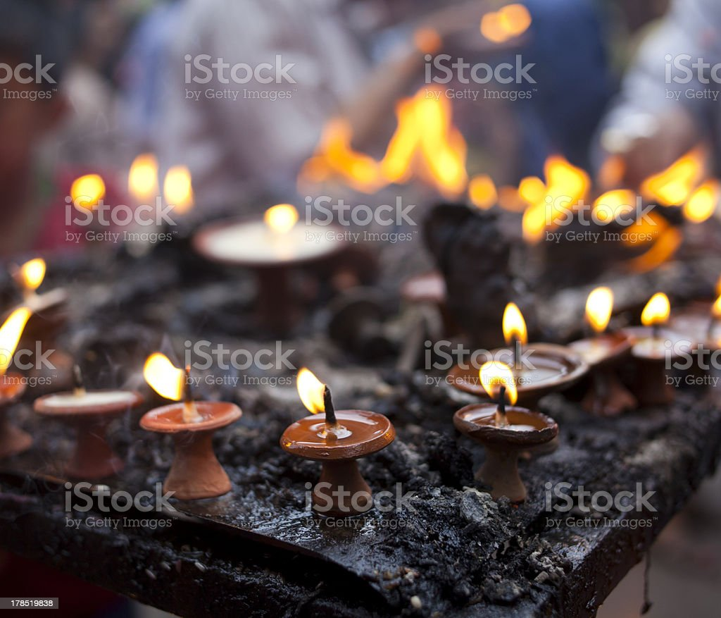 Oil/butter lamps in a temple, Nepal. royalty-free stock photo