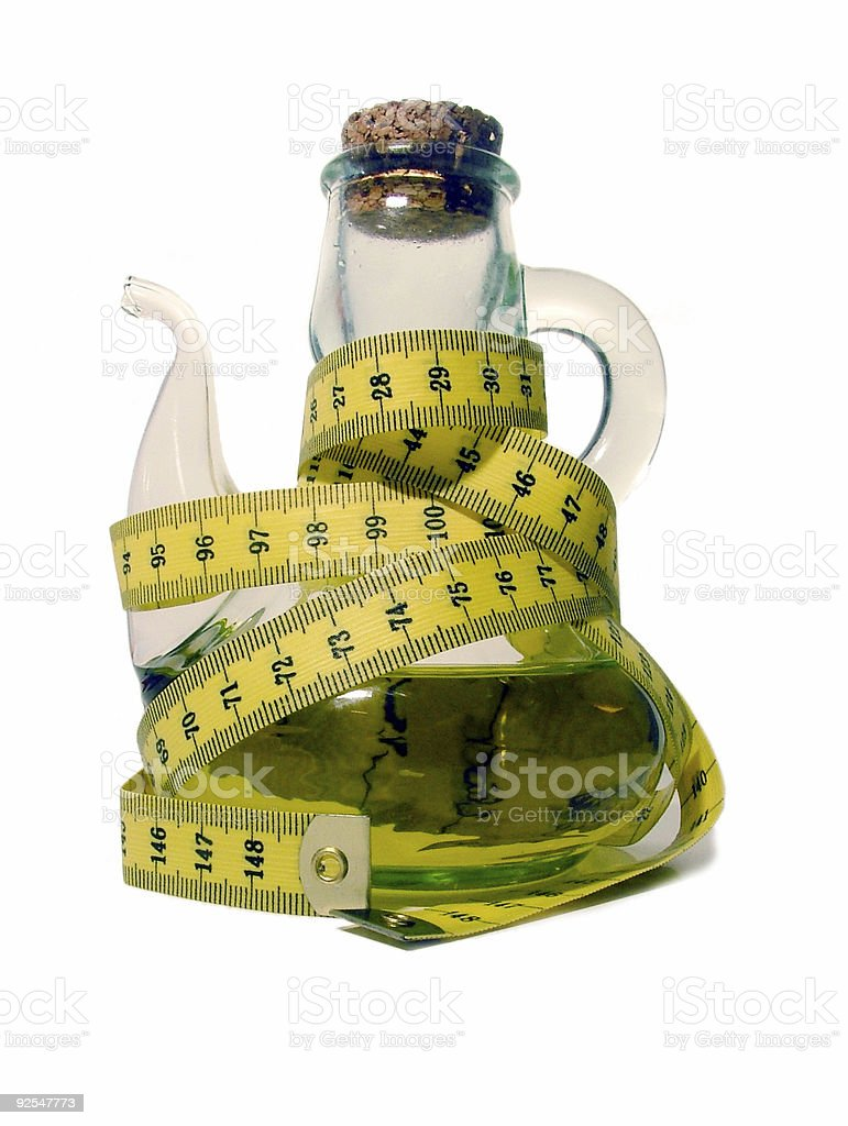 oilcan with measuring tape stock photo