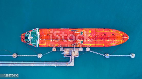 Oil/Chemical tanker ship loading in port, Tanker ship under cargo operation logistic import export business and transportation, Aerial view.