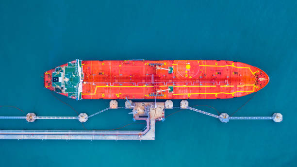 Oil/Chemical tanker ship loading in port, Tanker ship under cargo operation logistic import export business and transportation, Aerial view. stock photo