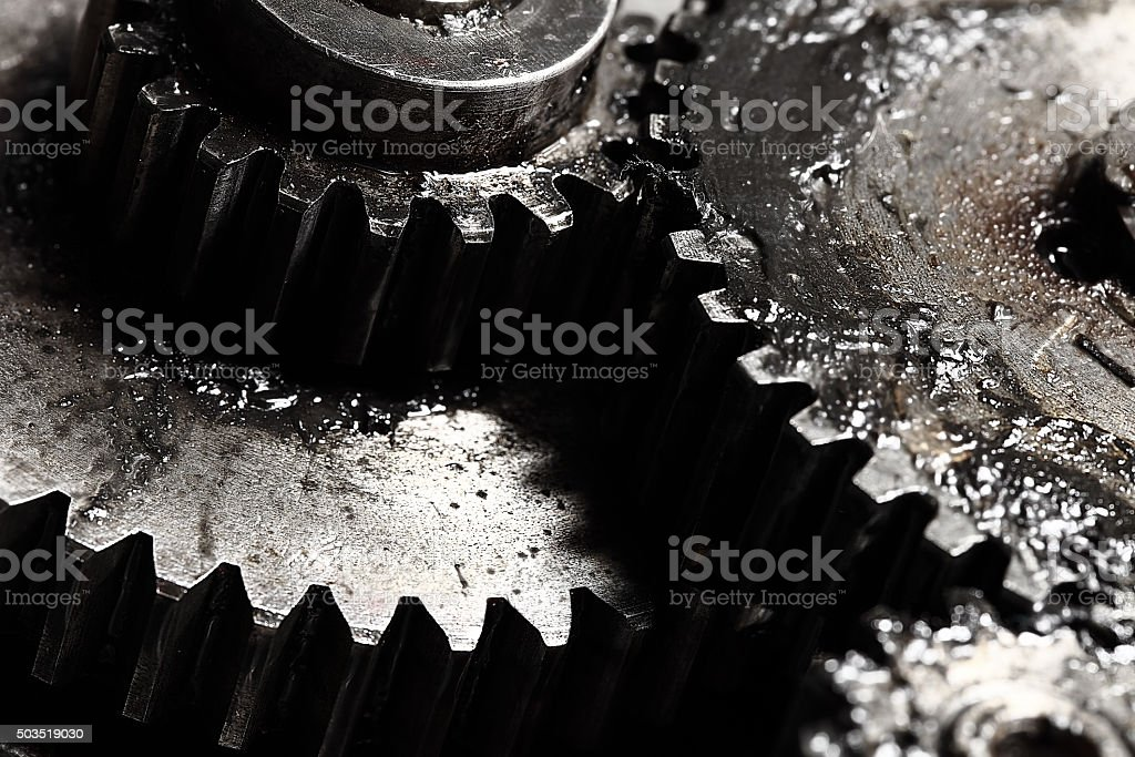 Oiled gears as small parts of large mechanism stock photo