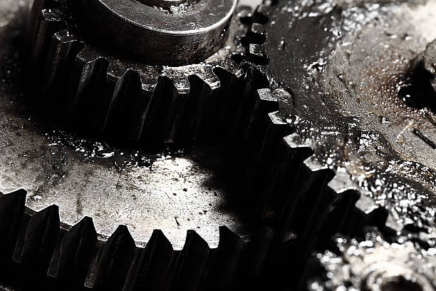 oiled gears as small parts of large mechanism - smering stockfoto's en -beelden