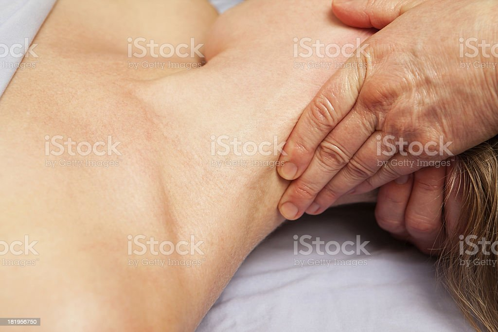 Oiled Hands Giving Neck Massage royalty-free stock photo