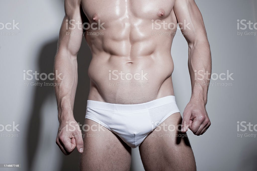 Oiled muscular male in underwear royalty-free stock photo