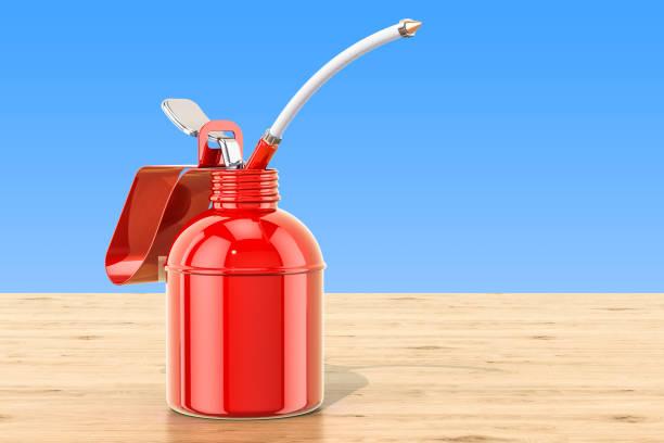 Aceitera, aceite rojo puede en la mesa de madera. Render 3D - foto de stock