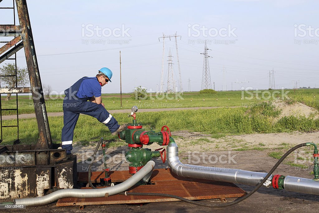 oilfield with worker and pipeline stock photo