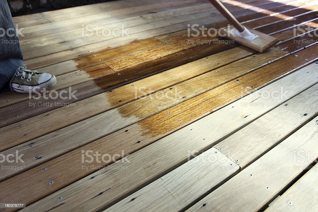 Oiling the deck stock photo