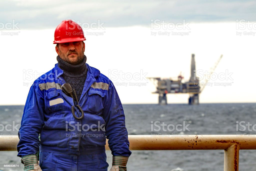 Oilman shift workers on the deck of the ship on the background o stock photo