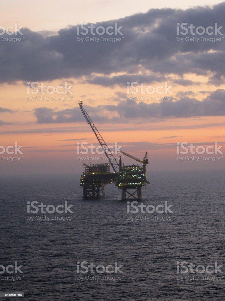 Oilrig at dawn stock photo