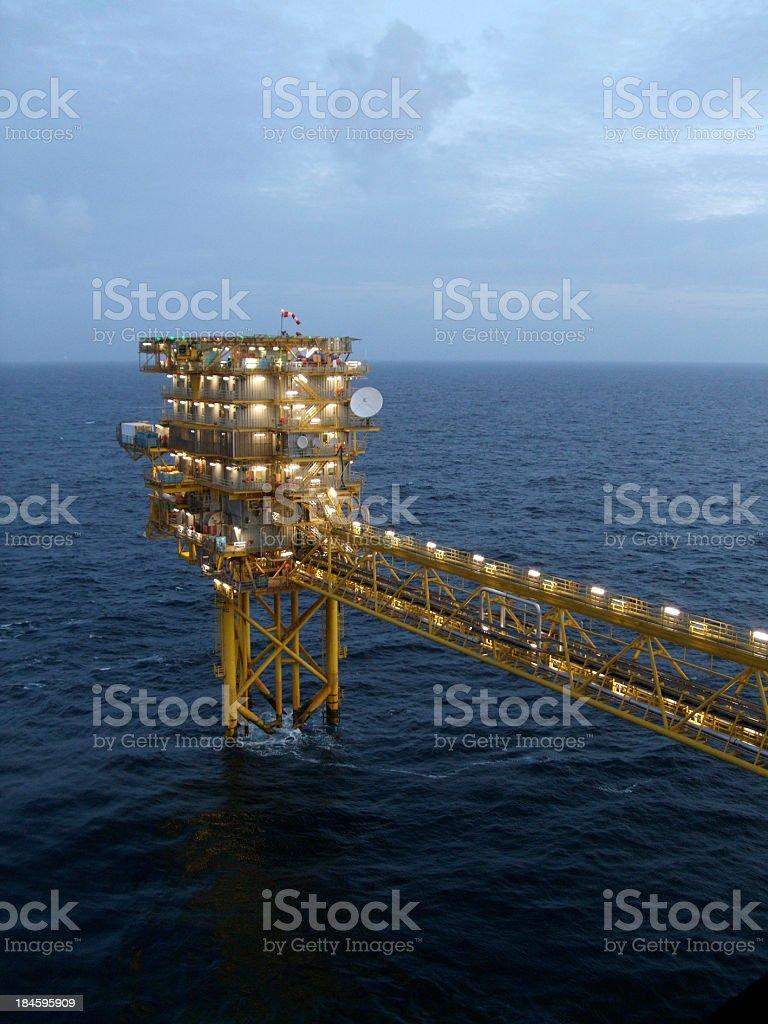 Oilrig platform in twilight royalty-free stock photo