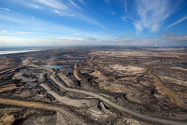 Oilsands Aerial Photo Expansive aerial view of a pit mining project in Alberta's Oilsands near Fort McMurray. alberta stock pictures, royalty-free photos & images