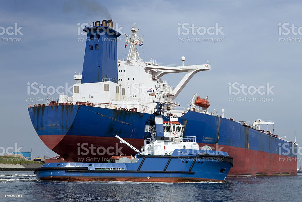 Oiltanker with tug-boat royalty-free stock photo