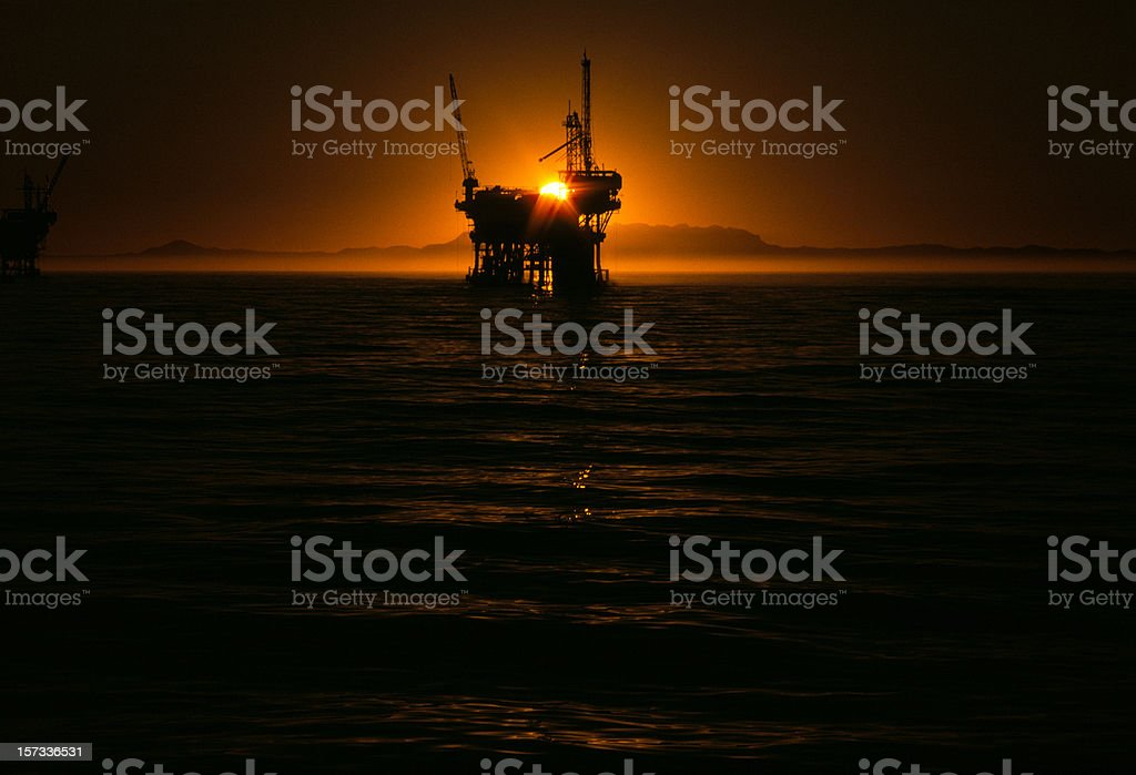 oil-well at sunset royalty-free stock photo